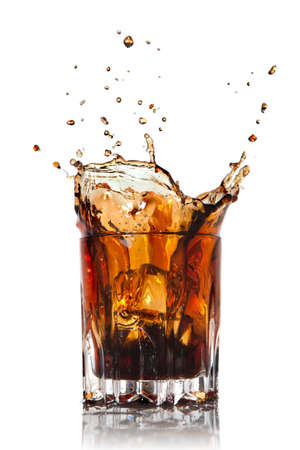 cola: splash of cola in glass isolated on white