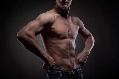 Muscular man on black Stock Photo - 8990063