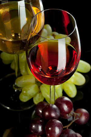 Red and white wine in glasses with grape. Top view photo