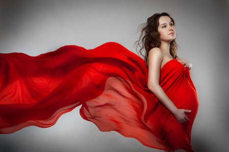Pregnant woman in red dress  photo