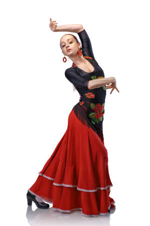 young woman dancing flamenco with castanets isolated on white photo