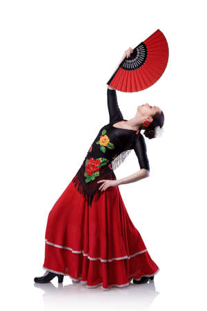 young woman dancing flamenco with fan isolated on white photo