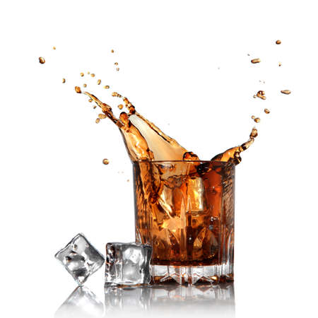 cola: splash of cola in glass with ice cubes isolated on white Stock Photo
