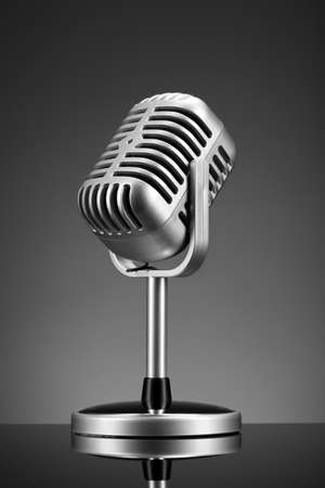 Retro microphone on grey photo