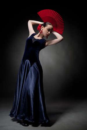 young woman dancing flamenco on black photo