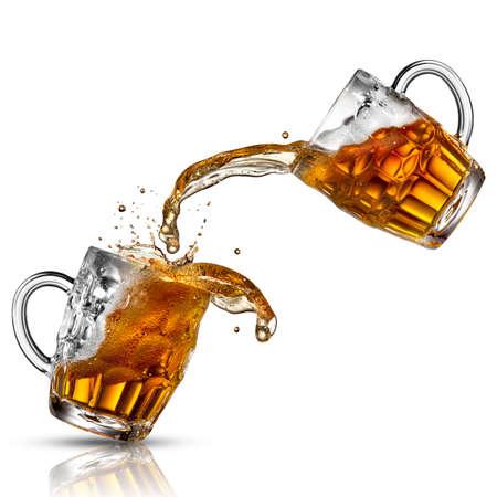 mug shot: Beer splash in glasses isolated on white