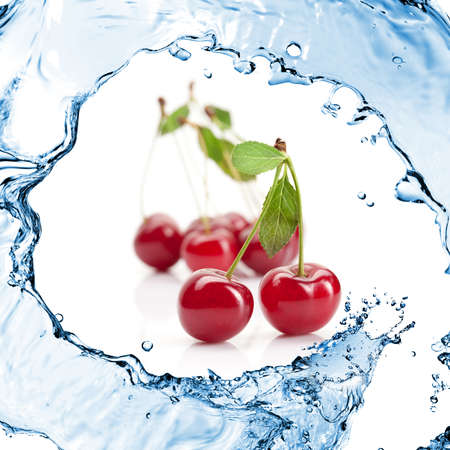 Red cherry with leaves and water splash isolated on white photo