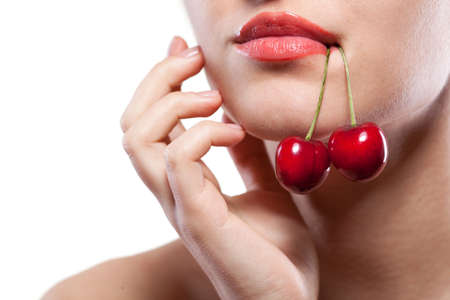 sexy food: Young woman with cherry isolated on white