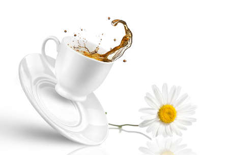 chamomile tea: Splash of tea in the falling cup with flower isolated on white