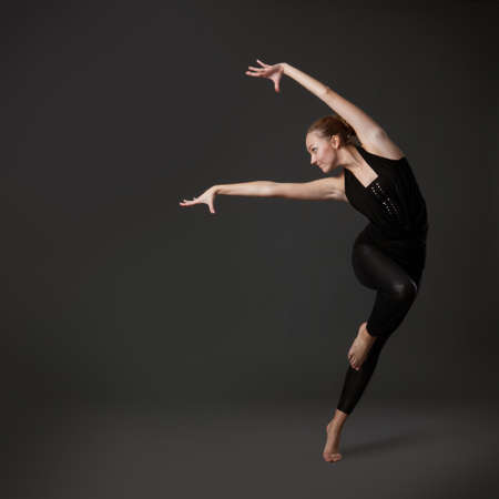 leap: attractive young woman dancing