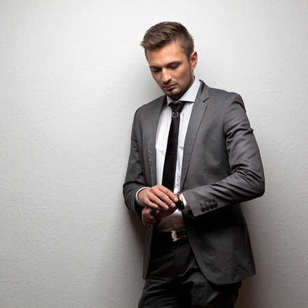 formal shirt: handsome businessman look his watch on white Stock Photo