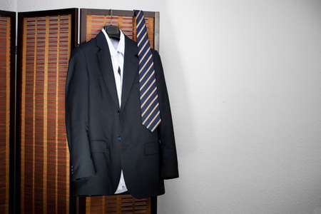 suit hanging on hangers photo