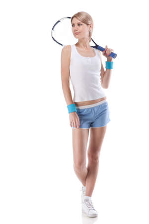 Portrait of young woman with tennis racket isolated on white photo