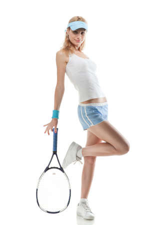Portrait of young smiling woman with tennis racket isolated on white photo