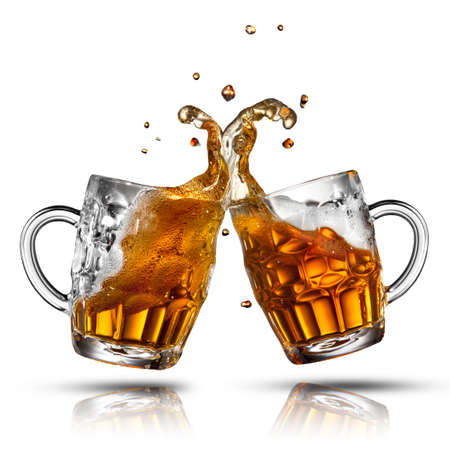 Beer splash in glass isolated on white photo