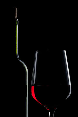 red wine in glass and bottle isolated on black Stock Photo