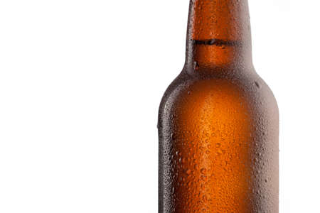 amber light: Beer bottle with water drops and frost isolated on white Stock Photo
