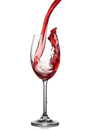 Splash of wine in glass isolated on white Stock Photo