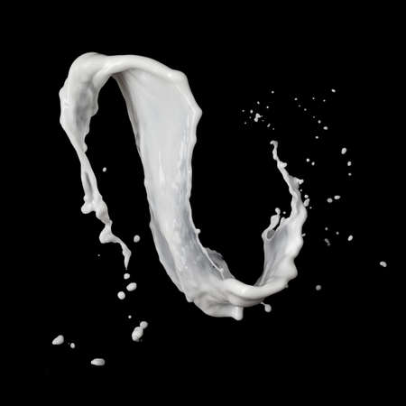 milk splash: milk splash isolated on black background