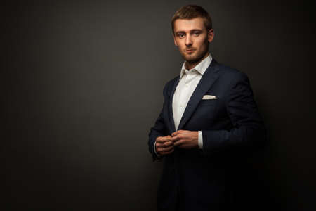 businesspersons: handsome businessman on black Stock Photo
