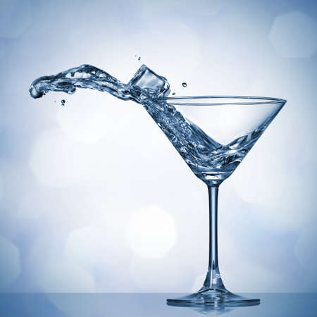 martini splash: Martini splash in glass Stock Photo