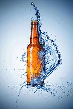 bottle of beer: Beer bottle with water splash