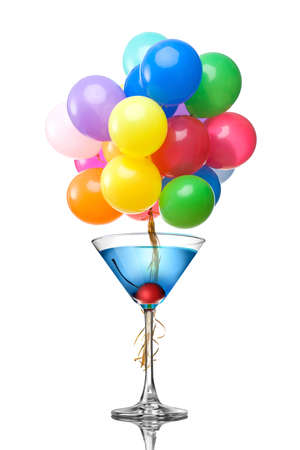 Blue martini cocktail with color balloons isolated on white photo