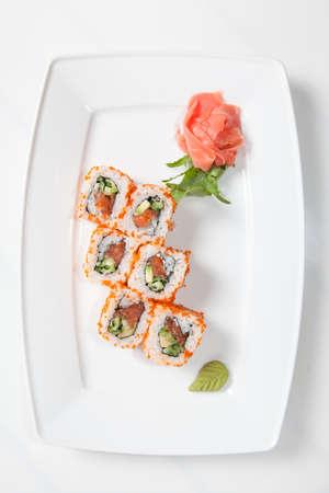 sushi plate: Maki Sushi on plate isolated on white
