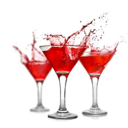 martini splash: Red cocktails with splash isolated on white Stock Photo
