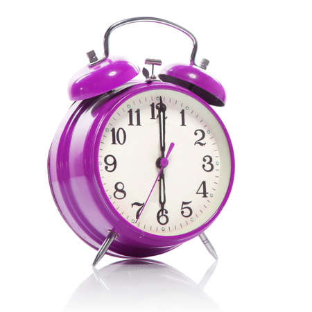 up wake: pink old style alarm clock isolated on white Stock Photo