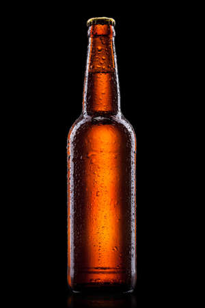 alcohol bottle: Beer bottle with water drops isolated on black Stock Photo