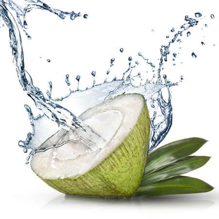 Green coconut with water splash isolated on white Stock Photo