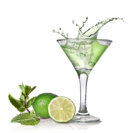 Green alcohol cocktail with splash, lime and mint isolated on white photo