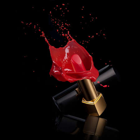 full lips: red lipstick with splash of paint isolated on black
