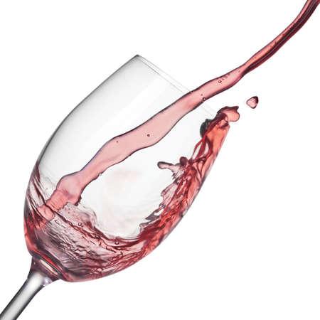 wineglass: Splash of rose wine in wineglass on white
