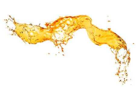 オレンジ色の水のしぶきが白で隔離