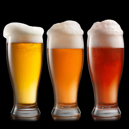 unbottled: Different beer in glasses isolated on black  Stock Photo
