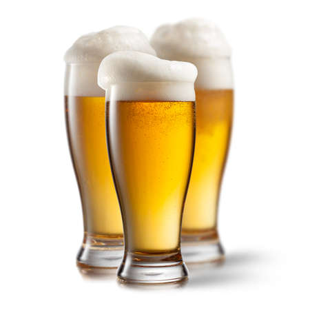 single beer: Beer in glasses isolated on white  Stock Photo