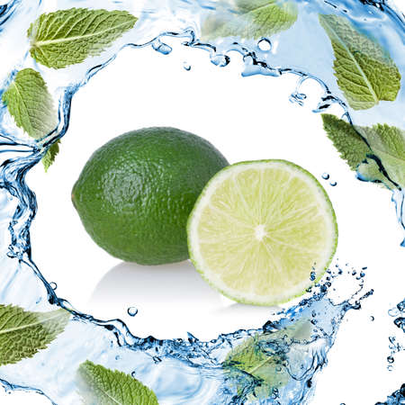 water splash with lime and green mint isolated on white photo