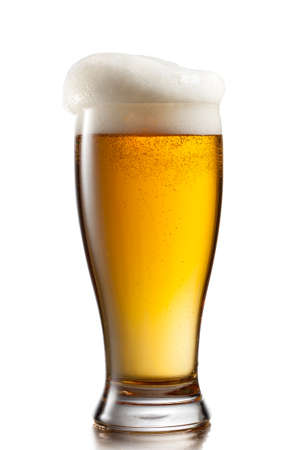 amber light: Beer in glass isolated on white background