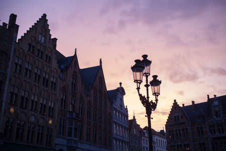 serenety: Silhouettes of city center houses in Bruges against beautiful sunset, Belgium Stock Photo