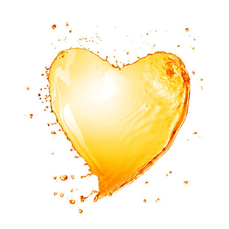 Heart from yellow water splash with bubbles isolated on white