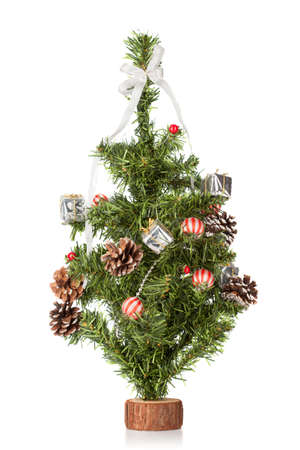Decorated christmas fir tree isolated on white photo