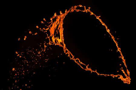 orange water splash isolated on black photo