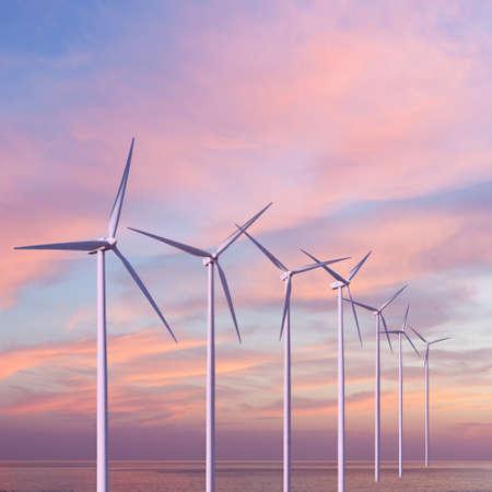 water turbine: Wind generators turbines in the sea on sunset