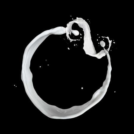 milk splash isolated on black photo