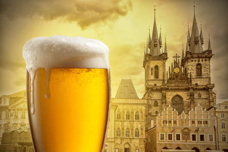 bohemia: Glass of beer against Tyn Church in Prague