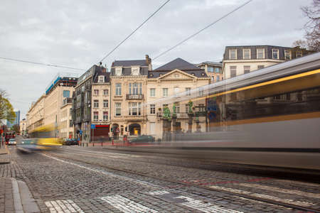displace: Tramway in motion on the street of Brussels near The Sablon Square Stock Photo
