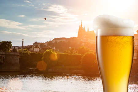 bohemia: Glass of beer against view of the St. Vitus Cathedral in Prague Stock Photo