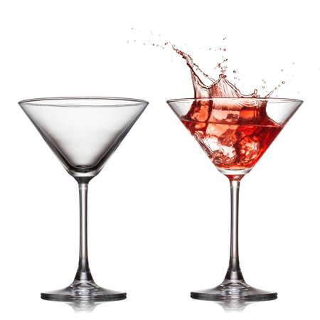 martini splash: empty and full martini glass with red cocktail with splash isolated on white